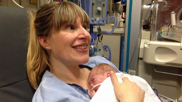 Kristen Schulze holds her newborn, Ryan, one of two twins born 12 weeks early. Schulze is part of a Mount Sinai program that lets parents take primary care of their premature children in the hospital, along with medical professionals.