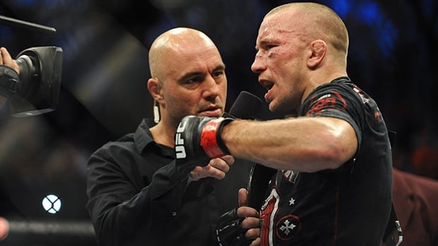 Georges St-Pierre is interviewed by Joe Rogan after his welterweight championship bout against Johny Hendricks during UFC 167 at MGM Grand Garden Arena on Friday.
