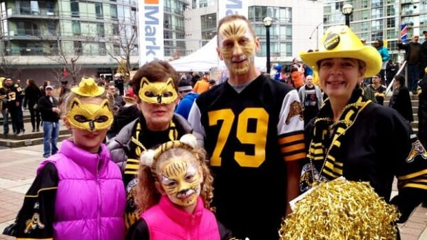 The Hills family from Burlington in full makeup to cheer on their Tiger-Cats at the CFL Eastern Division final in Toronto.