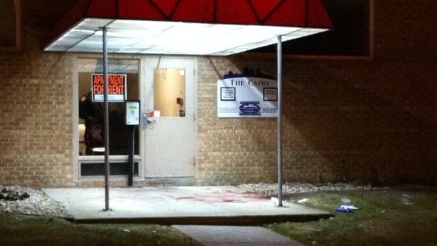 Blood is visible at the front entrance of the Capri Apartments in the 2100 block of Portage Avenue  on Friday night.