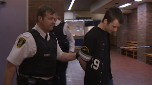 Scott Cleary is escorted to provincial court in St. John's in this file image.