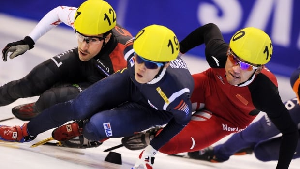 Canada's Michael Gilday, left, and China's Yongjun Yu, right, speed on track during the men's 1500 meters quarterfinal at the Short Track World Cup, in Turin, Italy, Saturday. Nov. 9, 2013. The final World Cup event was held in Russia over the weekend.