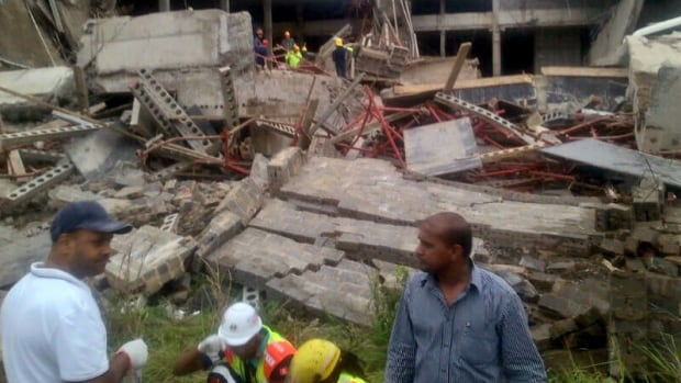 The roof of mall under construction collapsed in Tongaat, South Africa, on Tuesday. South African police said one person died and 26 were injured. Tongaat is near the eastern coastal city of Durban, and rescue teams rushed to the scene to help workers who were trapped beneath the rubble.