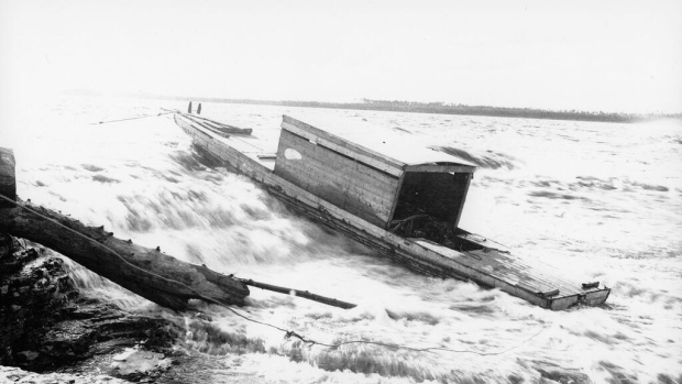 'From 1936, this is Dick Butler's boat on the Vermilion Chutes. Grandpa had told me horses were used to bring boats and barges down the rapids. You can see the ropes leading to shore, holding it in place.'