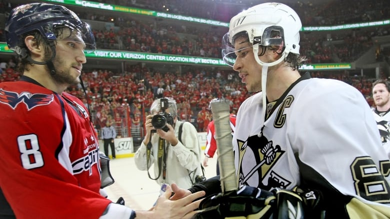 e6f9af8bb71 WASHINGTON - MAY 13  Alex Ovechkin  8 of the Washington Capitals and Sidney  Crosby  87 of the Pittsburgh Penguins shake hands after Pittsburgh s 6-2  victory ...