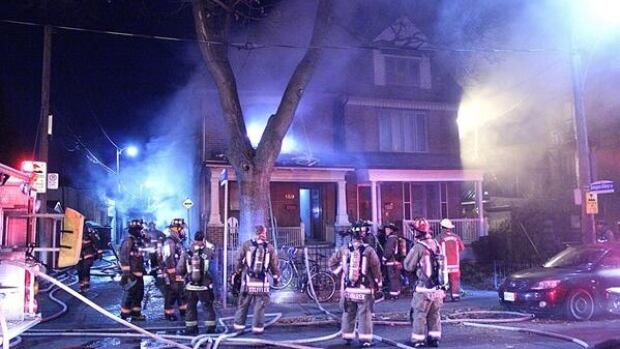 Fire crews respond to a house fire on Sheridan Avenue which sent one woman to hospital with critical injuries.