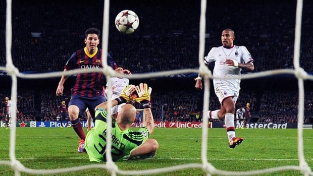 Barcelona striker Lionel Messi, left, scores in a 3-1 victory over AC Milan in UEFA Champions League at Camp Nou on Nov. 6.