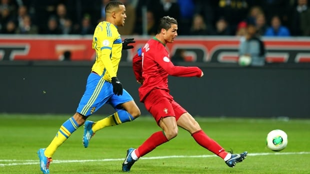Portugal striker Cristiano Ronaldo scores the first of his three goals in a 3-2 triumph over Sweden at Stockholm on Tuesday.