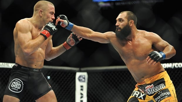 Johny Hendricks, right, lands a punch in a welterweight loss to Georges St-Pierre in UFC 167 at MGM Grand in Las Vegas, Nev.