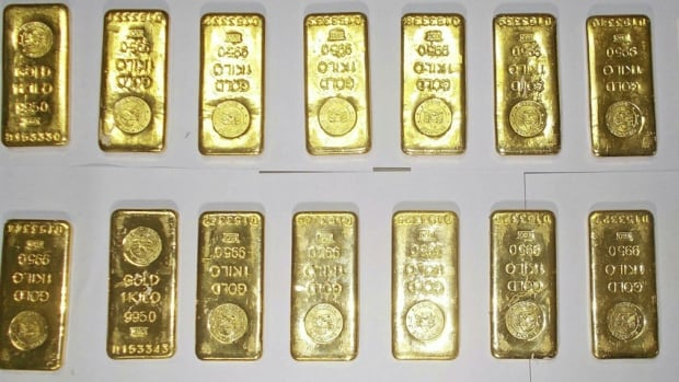 Some of the gold bars seized by custom officers on display at the international airport in Calcutta. Two lunch boxes hidden in the toilets of a Jet Airways plane triggered first a bomb scare and then a smuggling probe as the tins were found to contain 12 gold bars each.