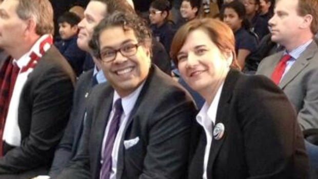 Calgary Mayor Naheed Nenshi and Banff Mayor Karen Sorensen smile as Olympic celebrations were announced for their communities Wednesday.