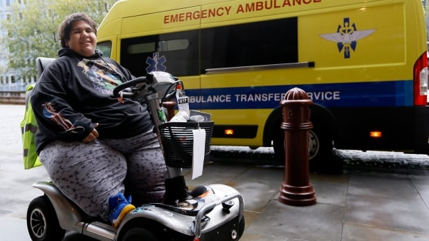 Kevin Chenais sits in his mobility scooter in front of an ambulance at St Pancras in London, on Wednesday, Nov. 20, 2013. Chenais, who suffers from a medical condition, will travel by ambulance and ferry back to France.