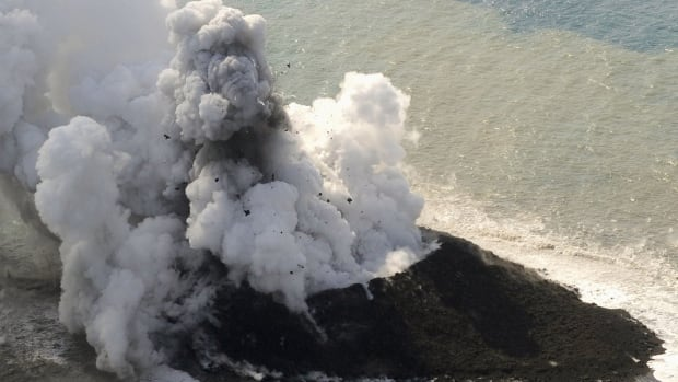 Smoke billows from a new island off the coast of Nishinoshima, a small, uninhabited island in the Ogasawara chain, far south of Tokyo.