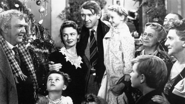 In this 1946 file photo, legendary actor James Stewart as George Bailey, center, is reunited with his family during the last scene of It's a Wonderful Life.