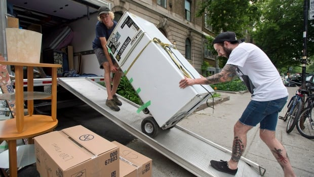 People pack up an apartment in Montreal. Alberta is attracting large numbers of people for work at the moment.