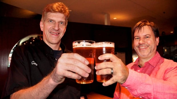Central City brewmaster Gary Lohin (L) and Simon Fraser University Chemistry Professor Uwe Kreis (R) toast to their new Science of Brewing course which starts in January.
