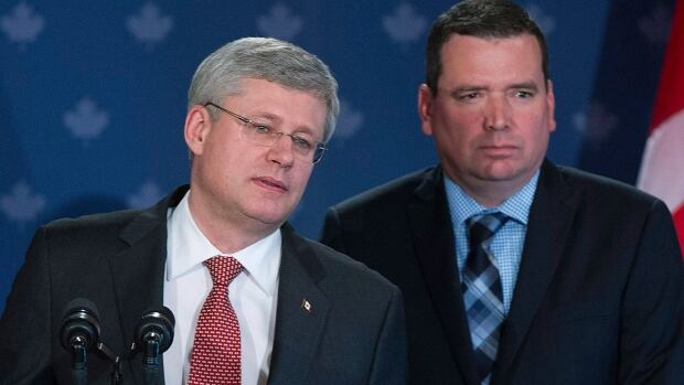 Prime Minister Stephan Harper and his minister for international development, Christian Paradis, answer questions at a news conference in Lac Megantic, Que., on Thursday.