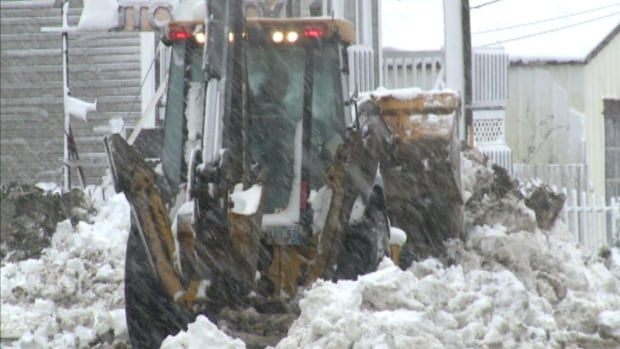 A snowplow clears some of the snow that fell Thursday in Badger.
