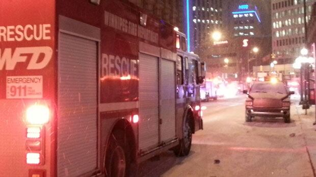 A number of emergency vehicles investigated a fire that shut down Notre Dame Avenue Friday morning and caused $100,000 to a century-old building.