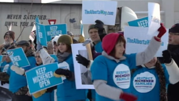Supporters of the Michener Centre rallied Friday outside the Red Deer hotel where the provincial Tories are holding their annual general meeting.