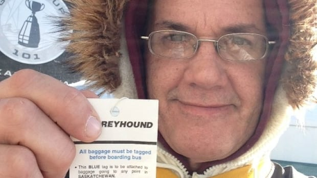 Hamilton Tiger-Cats fan Jeff May shows off his bus ticket to Saskatchewan after arriving in Regina Saturday morning for Grey Cup weekend.