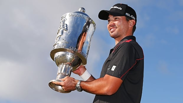Jason Day of Australia poses with the World Cup of Golf trophy at Royal Melbourne Golf Course on Saturday.