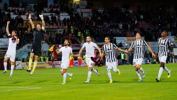Juventus players celebrate their 2-0 win over Livorno on Sunday.