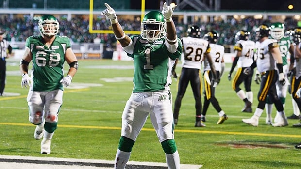 Saskatchewan Roughriders running back Kory Sheets celebrates a touchdown against the Hamilton Tiger-Cats during the fourth quarter.