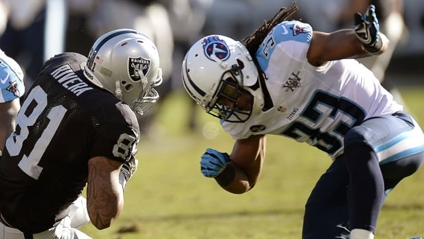 Titans safety Michael Griffin, right, hits the Raiders' Mychal Rivera in Sunday's game. Griffin was penalized for the helmet-to-helmet hit and on Monday received a one-game suspension as a repeat offender of the NFL's rules prohibiting hits to the head and neck area of defenceless players.