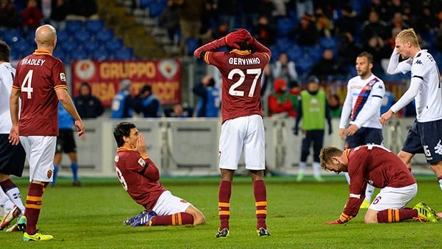 Roma react after missing a goal oportunity against Cagliari on November 25, 2013 at Rome's Olympic stadium.