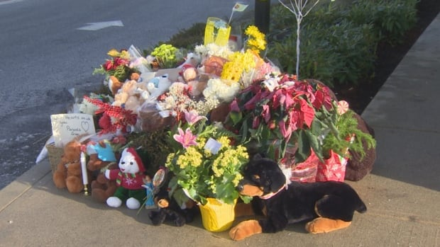 A memorial at the site of the accident that killed two-year-old Riddick Servio.