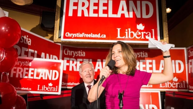 Liberal candidate Chrystia Freeland stands with Bob Rae as she celebrates after winning the Toronto Centre federal byelection.