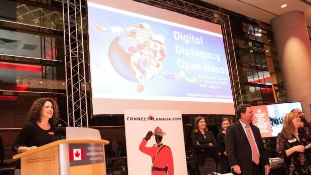 Katherine Baird welcomes attendees of the Digital Diplomacy Open House event at the Canadian embassy in Washington, D.C., on Thursday, November 21, 2013.