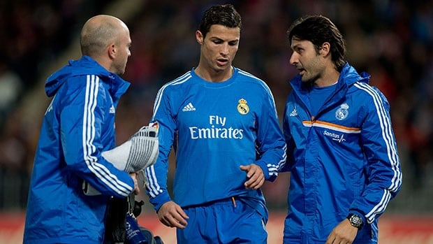 Cristiano Ronaldo, centre, left the pitch surrounded by Real Madrid medical staff during a Spanish league match against UD Almeria on Saturday.