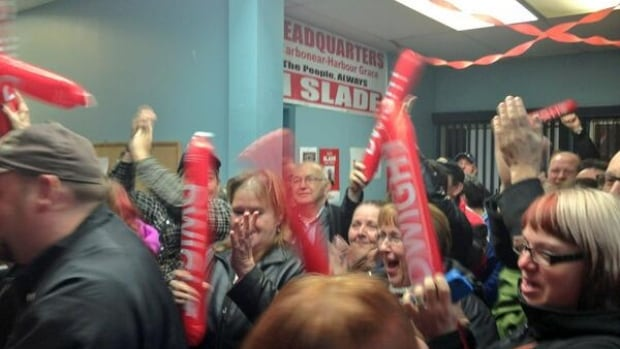 Liberal supporters await the triumphant arrival of Sam Slade after he won Tuesday night's byelection in the district of Carbonear-Harbour Grace.
