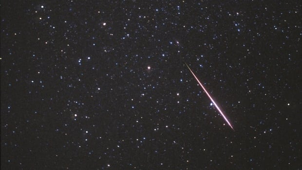 A Perseid meteor flashes across the constellation Andromeda on Aug. 12, 1997. Experts confirm a meteor was the cause of a loud boom heard on Tuesday night.