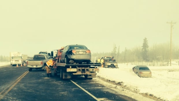 Crews work to clear the remnants of a 40-car pileup from Highway 21 near Township Road 510 in Strathcona County.