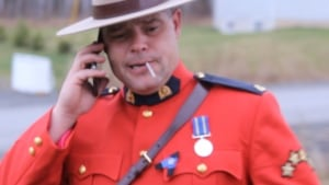 RCMP Cpl. Ron Francis smoking marijuana