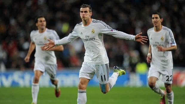Gareth Bale of Real Madrid CF celebrates after scoring against Galatasaray at Estadio Santiago Bernabeu on November 27, 2013 in Madrid, Spain.