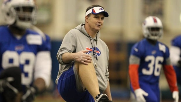 Buffalo Bills head coach Doug Marrone, centre, works out with the team during NFL football practice at the Ralph Wilson Field House in Orchard Park, N.Y., on Wednesday.  The Bills face the Atlanta Falcons on Sunday in Toronto.