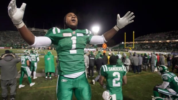 The mayor of Hamilton has to try one of these green jerseys on for size because of a lost Grey Cup bet but he'd prefer to be wearing black and gold.