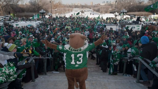 Gainer the Gopher gets cheers from Roughrider fans outside the Saskatchewan Legislative building during a victory rally Tuesday.