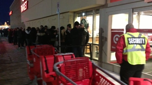About 100 people line up outside the new Target store in Sudbury on Friday, Nov. 29, 2013. Big chains and local shops across northern Ontario are staying open longer and offering special deals to compete with American and online retailers on Black Friday.