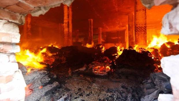 Angry garment workers set the blaze because of rumours that police shot and killed a colleague.