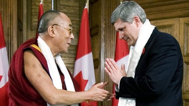 Prime Minister Stephen Harper thanks the Dalai Lama after exchanging Katas in Ottawa on Oct. 29, 2007. The first group of exiled Tibetans to immigrate to Canada under a federal resettlement program will arrive in Ottawa and Toronto on Friday.