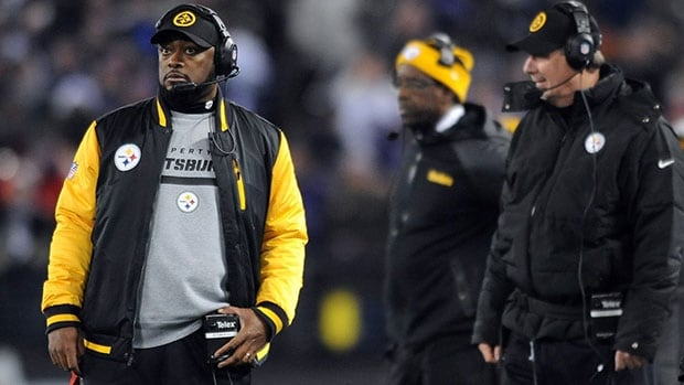 Steelers head coach Mike Tomlin, left, was accused of interfering with the Ravens' Jacoby Jones on a kick return.