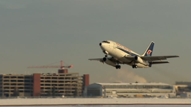 The Boeing 737 takes off from Edmonton City Centre Airport on Friday afternoon. The plane was moved from the Alberta Aviation Museum for a new museum at Villeneuve Airport northwest of Edmonton.