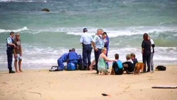 Zach Young's friends got him back to the beach, and bystanders tried