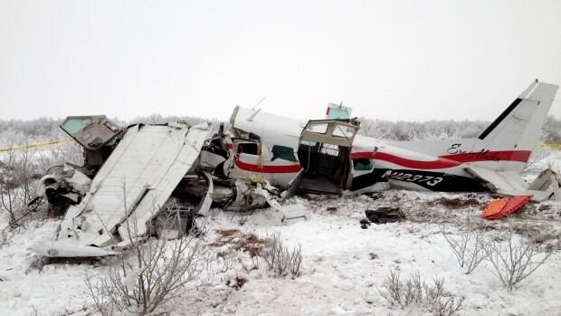 This image provided Saturday by Alaska State Troopers shows the wreckage of a plane that crashed Friday near St. Mary's, Alaska. Authorities said the pilot and three passengers died in the crash.