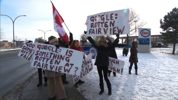 About a dozen protesters took up the cause of lack of bilingual signage at Fairview Pointe-Claire, calling it an infringement of their rights.